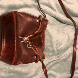 Leather bucket bag with silver embellishments